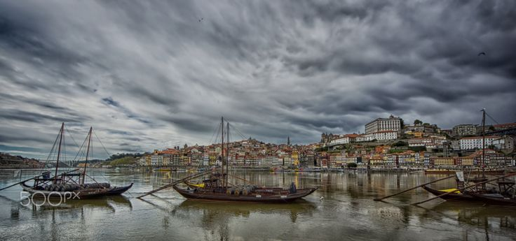 Rabelo boats, Porto, Portugal - The Rabelo boat is a traditional Portuguese cargo boat that for centuries was used to transport people and goods along the Douro River.  Native from the Douro region, it does not exist in any other place of the world. Its history is closely linked to the production and trade of port wine. Before the arrival of the railway, the rabelo was the fastest and the most efficient means of transport between the Douro Valley, where port wine is produced, and the city…