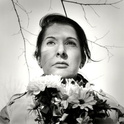 Marina Abramovic with flowers. http://www.dazeddigital.com/artsandculture/article/16842/1/the-da-zed-guide-to-marina-abramovic