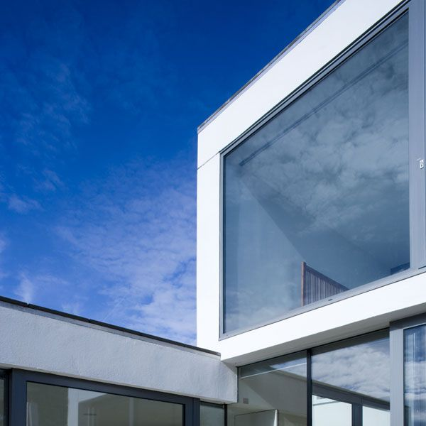The transition into the new is marked by a double height void which draws light into both the existing and new areas of the house while clear and opaque glazing are used to define hierarchies of privacy between the spaces.