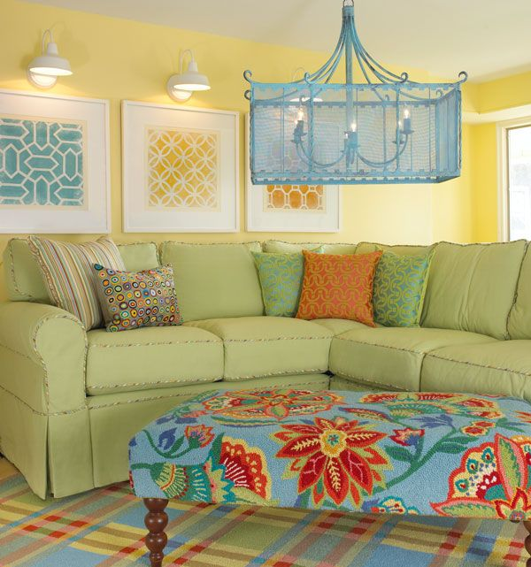 Sunny walk-out basement family room!! Love it all, but really love that sofa with print piping.