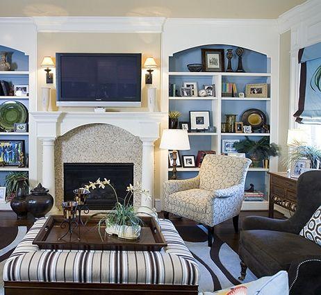 blue coastal living room. Blue background of white bookcases.