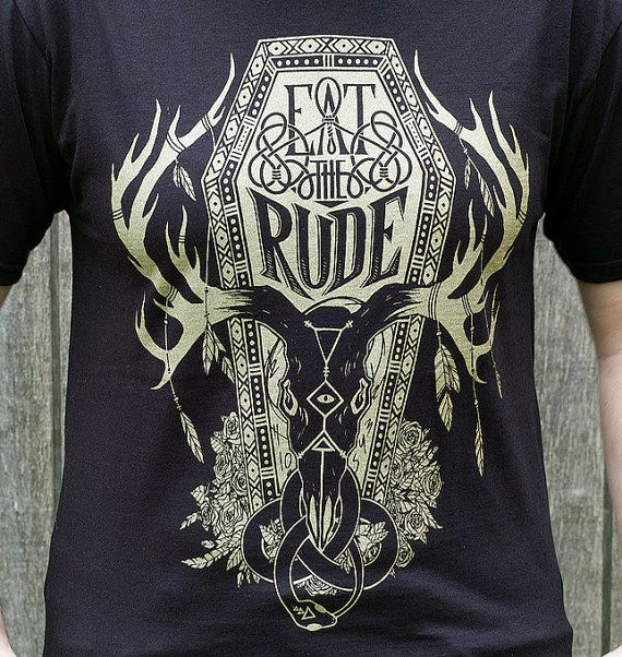 A Northwestern inspired Hannibal Eat the Rude design, printed with metallic gold ink on a crisp black t-shirt. [ T-Shirt Details ] Our Eat The Rude t-shirts are 100% jersey cotton and are screen printed by hand using high quality water-based ink for a soft, touchable, and durable design. This design is printed in iridescent metallic gold ink on black. [ Sizes ] Please read sizing information below before placing your order. Sizing can vary by brand and you may need a different size than…
