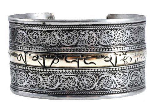 Tibetan White Metal Gold Plated Om Mani Padme Hum Filigreed Bracelet Om Tibetan Jewelry. $39.99. Made from White Metal and Plated with Gold. Width: 1.5 Inches. Handmade in Nepal. Om Mani Padme Hum Prayer Engraved and Plated with Gold. Size: One Size Fits All