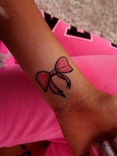 cute bow tattoo. ♡