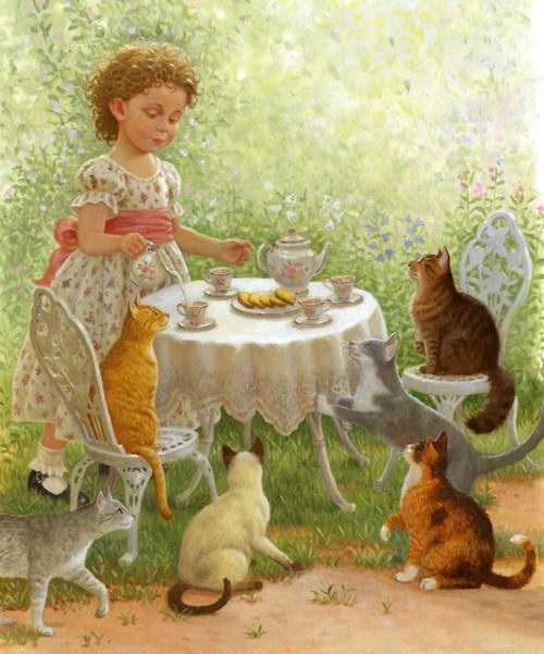 Two of my favorite things...tea cups and cats :)