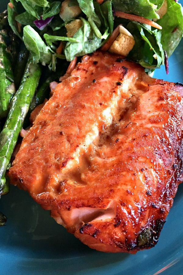 """Broiled Teriyaki Salmon 2 lbs fresh salmon, about 1"""" thick cut into serving size pieces 1 c teriyaki marinade 1 T dried ginger 1/3 c dark brown sugar In a small bowl, combine teriyaki sauce, dried ginger, dark brown sugar. Pour into a ziploc bag; add the salmon. Preheat broiler to high. Place salmon on a prepared (sprayed) baking sheet. Broil for 5-6 mins, flip, then broil for another 5-6 min more. With skin, broil for 8-10 mins total, skin-side down. Will be a little darker on top than…"""
