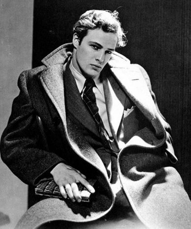 Marlon Brando, circa 1950s, a.k.a. the power of talent, a fantastic suit and coat, and a smolder.