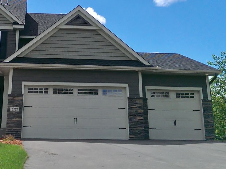 New home construction 3 car garage roof gable vinyl Vinyl siding house plans