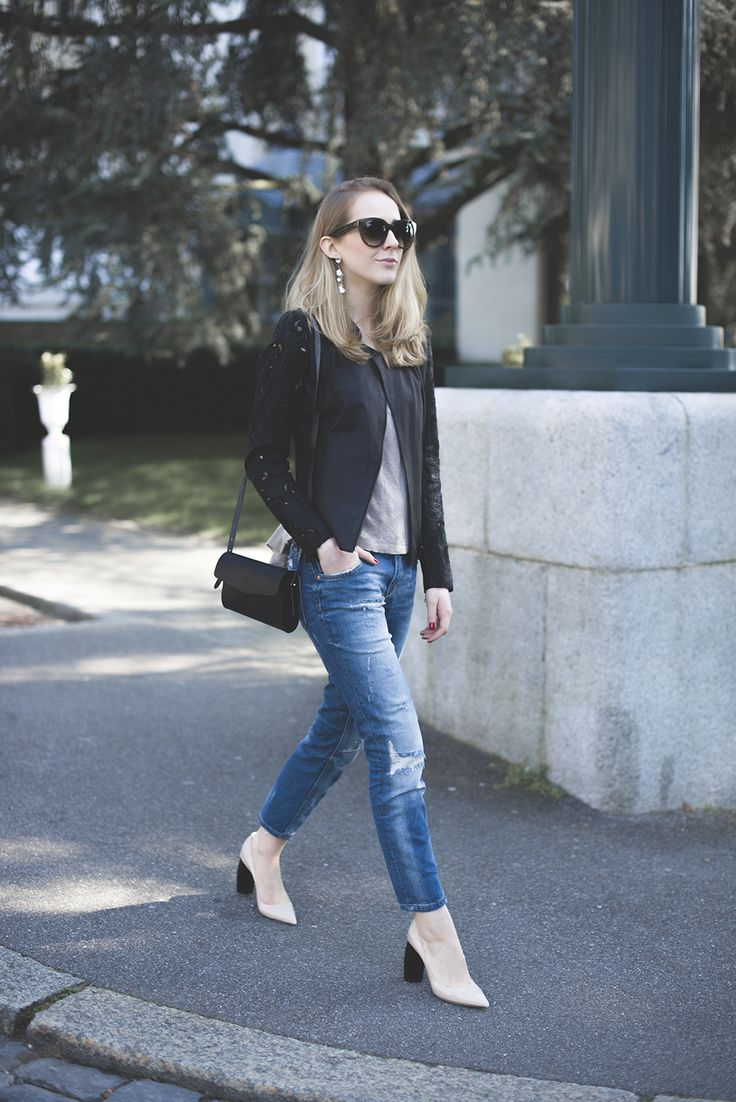 Wear a black lace blazer with blue jeans for a casual level of dress. White leather pumps will instantly smarten up even the laziest of looks. Shop this look for $60: http://lookastic.com/women/looks/crew-neck-t-shirt-and-crossbody-bag-and-jeans-and-heels-and-blazer/1655 — Grey Crew-neck T-shirt — Black Leather Crossbody Bag — Blue Jeans — White Leather Pumps — Black Lace Blazer