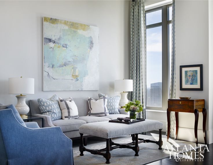 "In the sitting room, a striking piece of art by Jenny Nelson echoes the color of the sky. ""As a former art consultant, I truly believe that art completes a home and gives rooms unique personality,"" says DeLoach."