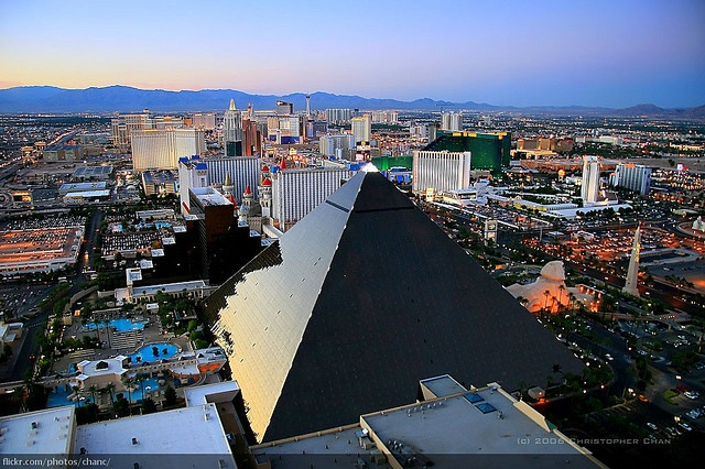 The Luxor Pyramid was among the first of a decade-long wave of new megaresorts to emerge on the Las Vegas Strip in the 1990s. Opened in 1993 after only eighteen months of construction, the Luxor debuted with 2,526 guest rooms, a gigantic casino area, a showroom, restaurants, and entertainment venues on its 2nd floor. At a base length of 183 meters (600 ft) and a height of 110 meters (350 ft) it is considerably smaller than its famous model, the Great Pyramid at Giza.