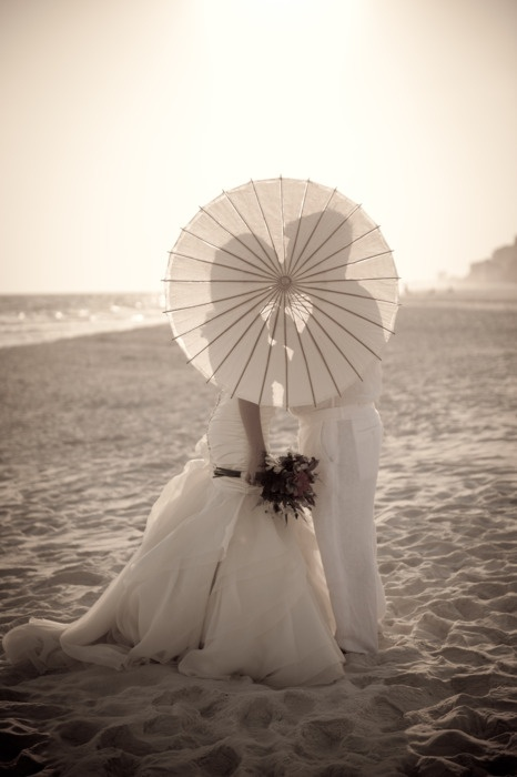 Paper parasol for a private moment.  Destin beach wedding.  http://paradisobeachweddings.com Annie Turner Photography annieturnerphotography.com