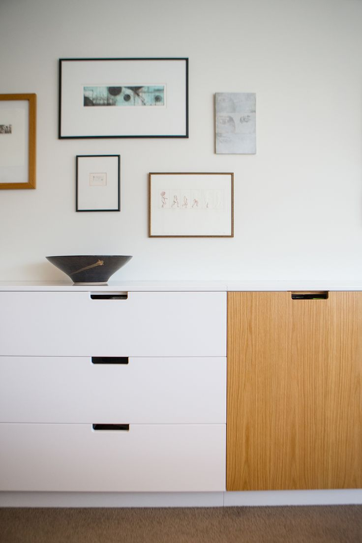 Furniture 601. Sally Steer Design Ltd. Wellington, New Zealand. Living room storage in white with Oak plywood features and cutout handles.