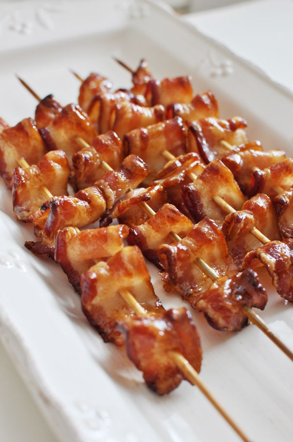 Bacon skewers: 2 pieces of folded bacon (folded like a fan) and then skewered on wooden skewers. Place on a wired rack in a cold oven. Turn oven onto 400 and back for 20 minutes or until desired doneness. Remove and while bacon is still warm, brush on maple syrup. Mmm! They were delish!