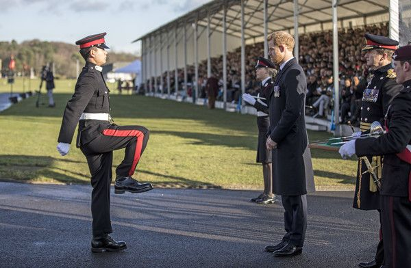 Prince Harry Photos - Prince Harry presents the International award to officer cadet Tang Mindong from the people's republic of China during the Sovereign's parade at Royal Military Academy Sandhurst on December 15, 2017 in Camberley, England. - Prince Harry Attends the Sovereign's Parade