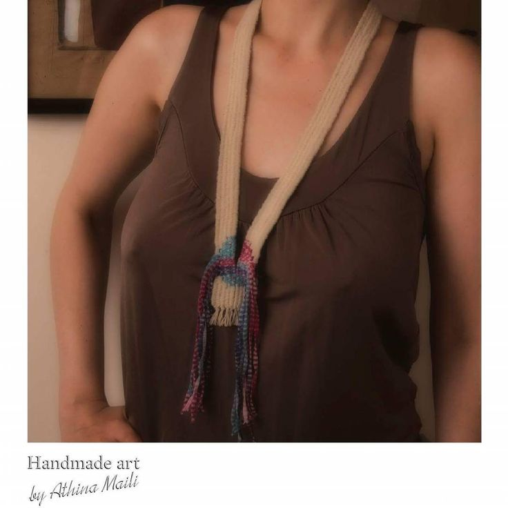 Handwoven linen and cotton neckpiece with fringes. Photo credi