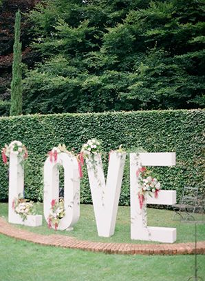 giant Love sign at wedding ceremony aisle. Photography: Qlix Photography/ Styling & Coordination: Blooming Love Events / Flowers: Sassafras Flower Design / Wedding Stationery: Lauren Dillon Designs / Giant LOVE letters: Little Love Birds / Wedding cake: Kiss My Cakes / Prop hire:Blooming Love Events & My Sweet Event / Tablecloths: Table Art / Venue: Cloudehill Gardens /