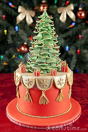 Christmas fondant cake against christmas tree background