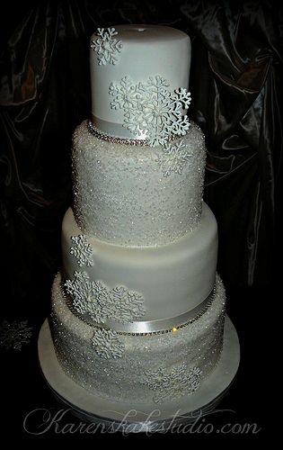 Get Inspired: A crystalline wedding cake with snowflakes and silver trimmings, for that icy winter-themed look!
