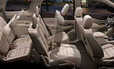 The 2017 Acadia Denali mid-size luxury SUV features fold-flat 2nd and 3rd row seats.