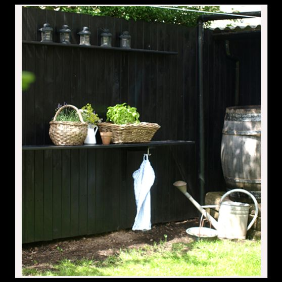 Black wooden fence with table top on