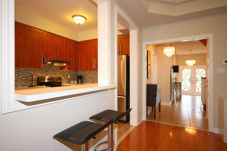 semi open concept kitchen - the wall is load bearing we could leave up a pillar or beam