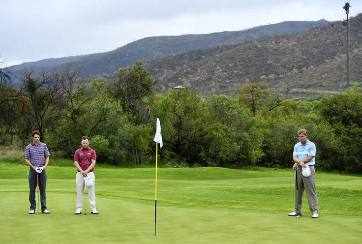 Peter Uihlein, of the United States, Branden Grace of South Africa and Ernie Els of South Africa observes a minute of silence for South Afri...