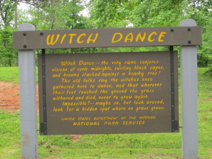 Legend has it that witches used to meet in this very location so that they could perform ceremonies, which involved dancing. It is said that wherever the witches' feet touched the ground during these dances, the grass would wither and die, never to grow again. These barren or scorched spots can still be seen to this day.  Witch Dance, Natchez Trace Parkway milepost 233.2