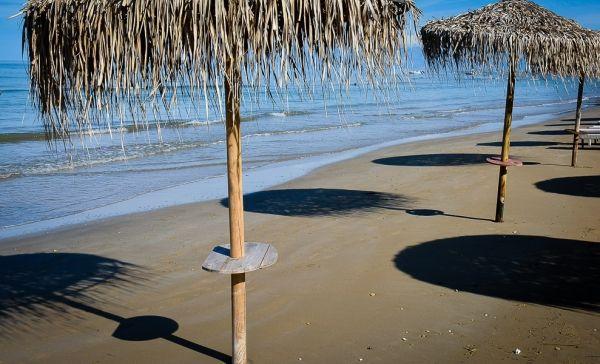 Lonely umbrellas in Saint Stefanos beach