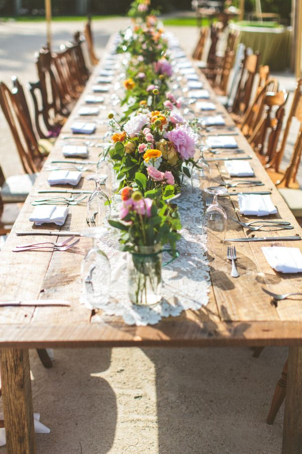 Mismatched antique chair backs at a long table