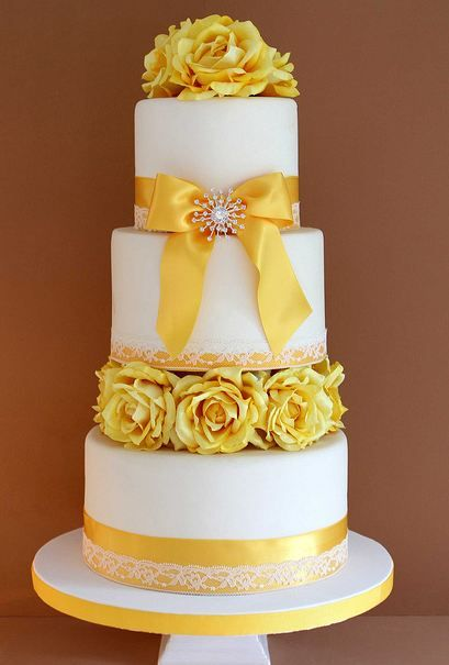 White With Yellow Tier Round White Wedding Cake With Yellow Flowers And Ribbons Jpg