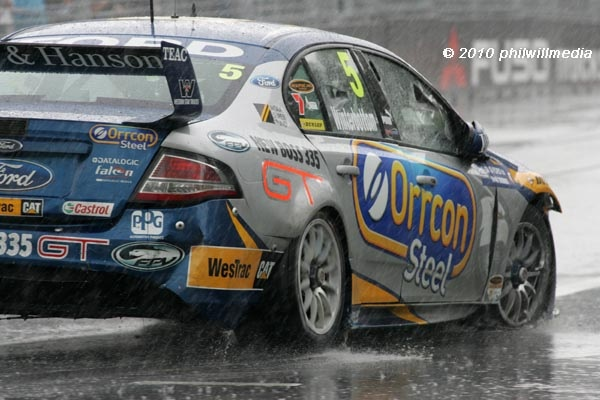 Image from the Saturday V8 Supercar race at the 2010 Telstra 500 on the streets at Homebush Olympic Park. A torrential downpour caused mass carnage with the three championship contenders all going into the wall of the narrow street circuit. To see mo As a photographer I have a passion for photographing the V8 supercars.