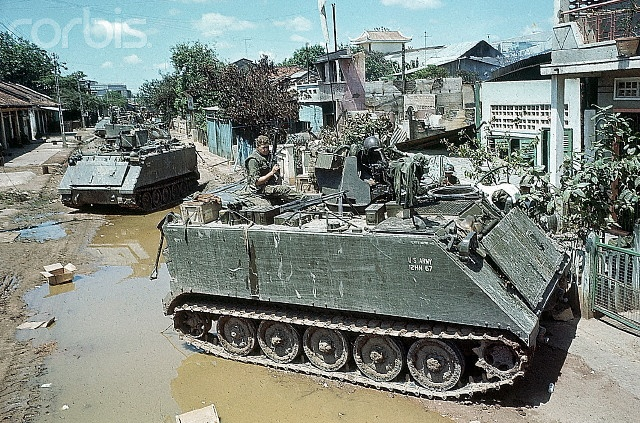 5/8/1968-Cholon, Vietnam: Tanks and armored personnel carriers of the U.S. 25th Infantry Division, May 6th, seal off an area of Cholon where heavy fighting erupted. The Cholon section continued to be the main battle ground May 8th as the Communists pressed their four-day-old offensive. Here, a line of tanks appear to be approaching a residence.