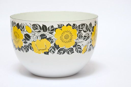 Kaj Franck Finel Enamel Yellow Flower Mixing/Salad Bowl:  Originally produced by Finel, Kaj Franck's enamel bowls have become hugely popular and iconic. This design is one of many produced and features the Ritari (knights) medieval character motif by Esteri Tomula. It can be used for salads, mixing or just as decoration.