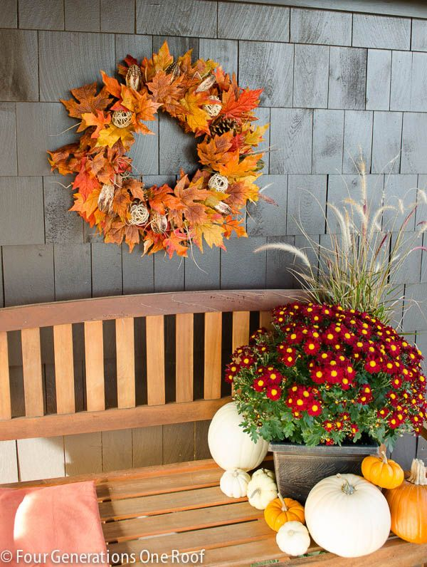 Create a fun wreath and seating area with mums & pumpkins