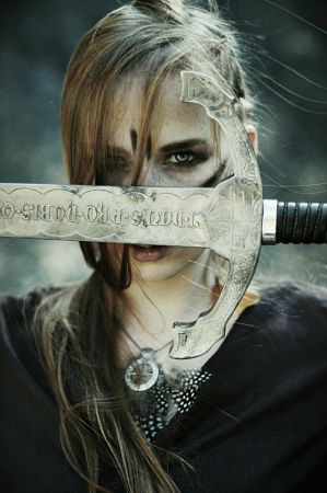 "She drew the sword out and stared at the letters inscribed on the blade. ""Where did you get this?"" ""Garbage."" I answered. She narrowed her eyes at me. ""This belongs to the most powerful knight in the land and you're going to tell me you got it in the trash?"""