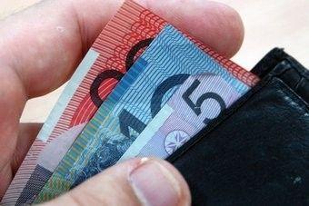Inflation eases sending Australian dollar lower