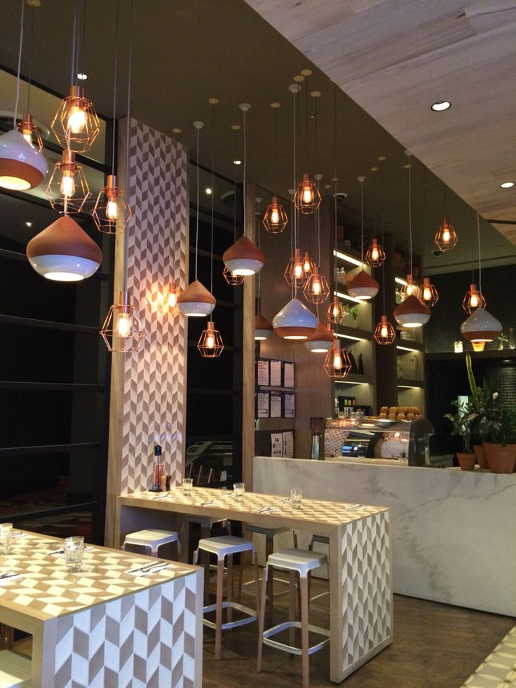 Cotta Cafe on the gaming floor of the casino uses a wide range of different textiles in there space from ceramic light fittings, tiled table/walls, marble look counter (quartz) and wood paneling on the ceiling.