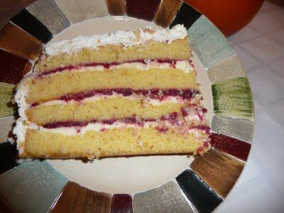 Danish Layer Cake, with almond and raspberry filling, and whipped cream on top.
