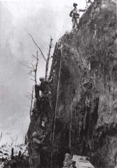 Desmond Doss, the only conscientious objector ever to receive the Medal of Honor.  He lowered 75 wounded soldiers one at a time down this cliff in one day during WWII.  Despite his refusal to carry a gun, his men respected him immensely.Wounds Soldiers, Men Respect, Conscientious Objector, Maeda Escarpment, 75 Wounds, Escarpment 04, Desmond Doss, Lower 75
