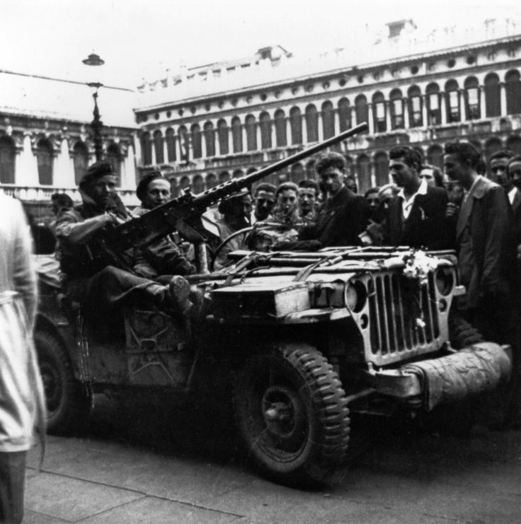 A jeep belonging to PPA (Popski's Private Army) stationed in Piazza San Marco , Venezia. Venice, Italy April 30 1945