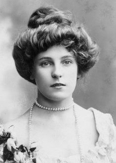 """Gibson Girl: A hairstyle popular during the 1890s and is seen in the """"Gibson Girl"""" illustrations of the time. This style favored deep, soft waves around the face. Hair was built up at the front in a """"pompadour""""."""