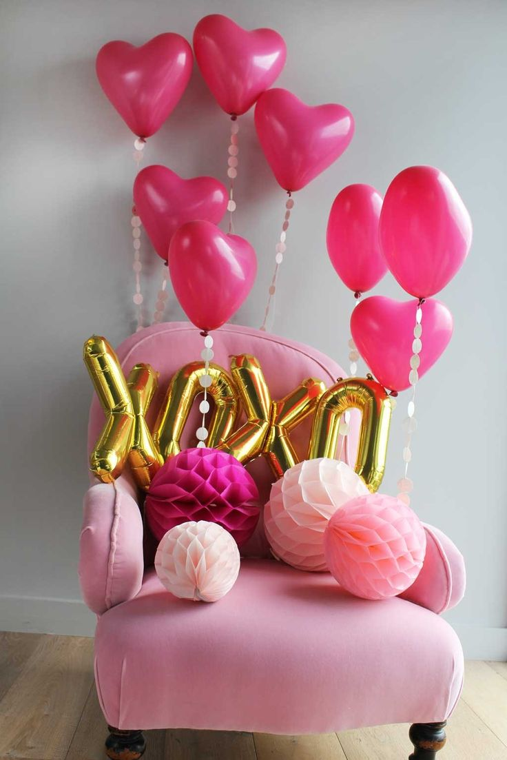 Super cute pink decor for Galentine's Day - with lots of heart shaped balloons!