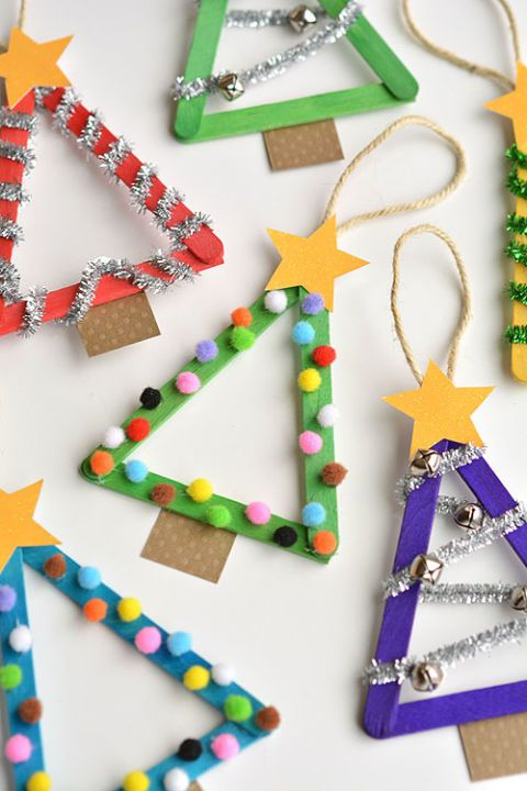 Popsicle Stick Christmas Trees: Make the most of popsicle sticks by sprucing them up with fun accents like bells, pom poms and pipe cleaners. Find more easy and cool DIY kids Christmas craft ideas that can decorate your home this Christmas here.