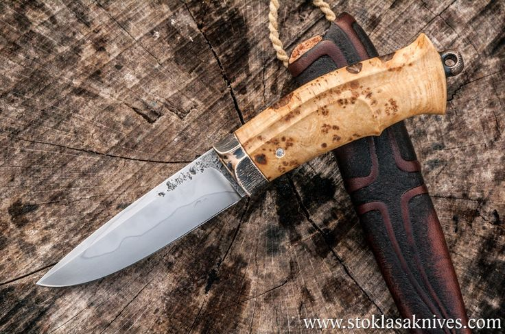 The blade is forged of W2 tool steel and it´s differentially hardened. The handle is carved of ash burl wood and the fittings are of bronze....