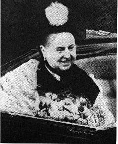 This is one of the only pictures of Queen Victoria smiling. I think this was around the time of her Golden Jubilee. For special occasions, she would wear white shawls and other accent pieces with her black mourning.