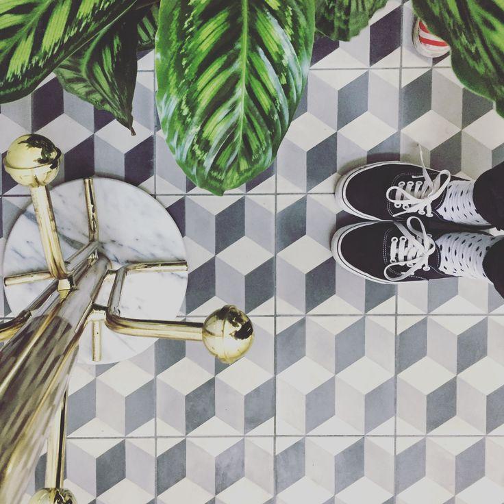 escher block tiles, marmer and golden touh. vans shoes, greenery!