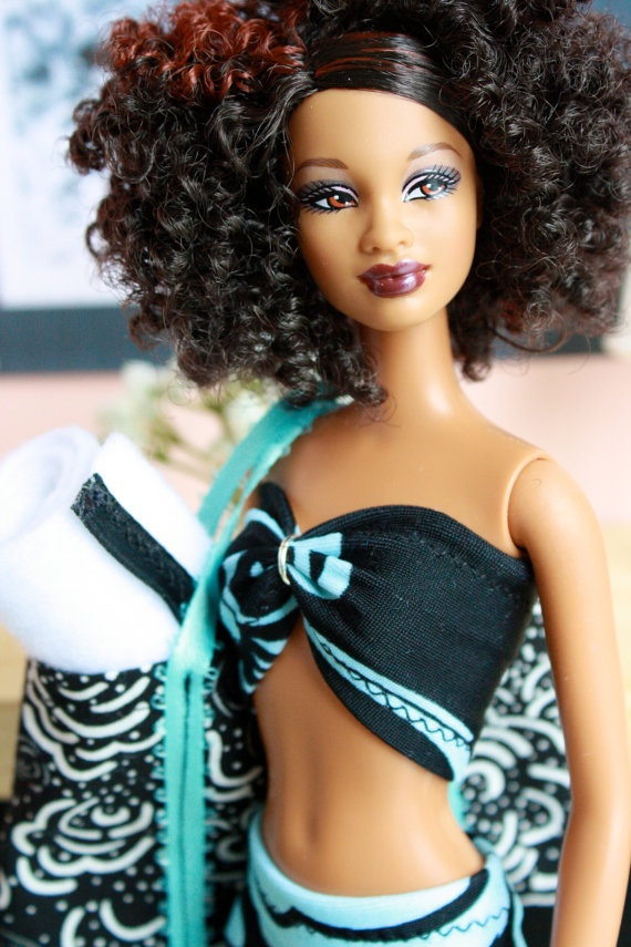Barbie beach set with towel and bag. Just an idea..... Love the doll too, I wish they made more curly hair dolls...