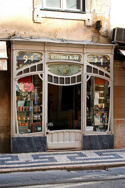 Beautiful Art Nouveau shop front. IT'd be hard to go to work, 'cause you'd want to sit outside and just admire the facade!