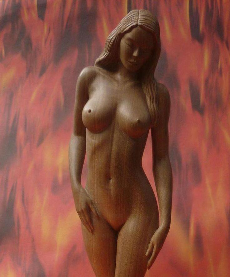 Sculpture of nude woman in hazel wood, by Carlos Baez Barrueto